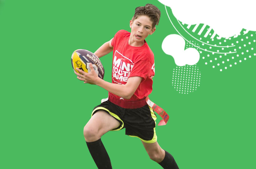 Boy playing tag rugby
