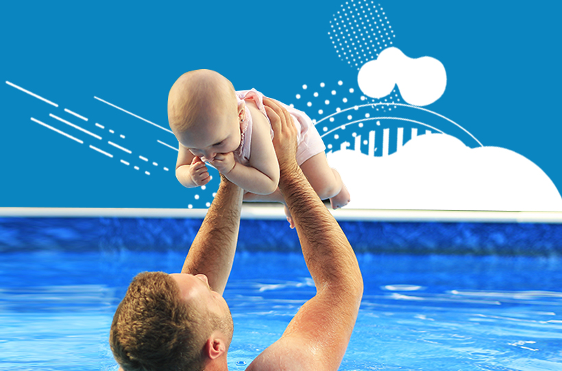 Man lifting baby in a swimming pool