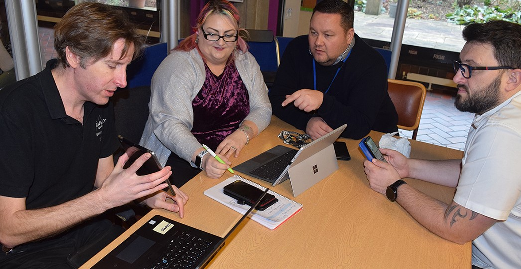 Staff taking part in the digital cafe drop ins