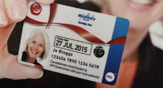Woman holding an older person's bus pass