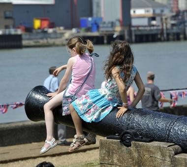 Two children sitting at The Historic Dockyard, Chatham.