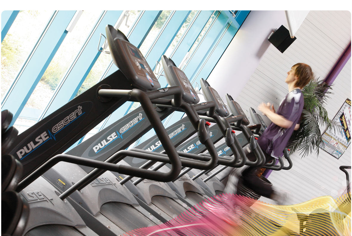 Photo of a person exercising in a sports centre