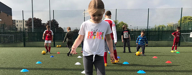 Girl playing football at Strood Sports Centre